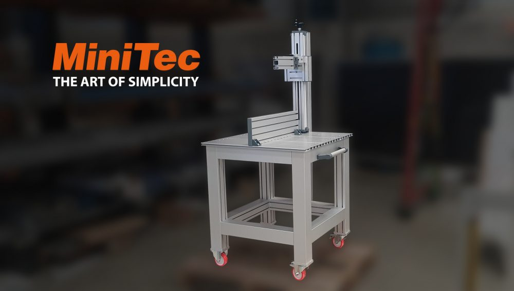 This aluminium and stainless steel table was built to aid the in the assembly of an extremely high-strength magnet. Castors and handles were added for movement around the lab .