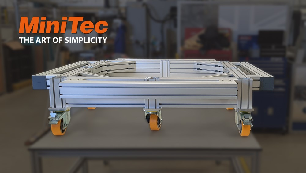 This customised MiniTec transport frame is perfect for moving heavy items around a warehouse. The frame has 6 castors, allowing for smooth controlled movement.